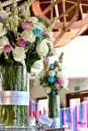 Floral arrangements with pink, blue and purple accents to complement client's theme colours.